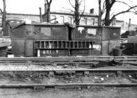 Part of Darlington Works scrapyard showing the <I>stores</I> in May 1962. These stores, based on the grounded body shells of two former <I>Sentinal</I> locomotives, would have held cutting gear and various tools and equipment necessary to carry out the day to day work of the yard. The two Sentinals already subjected to the cutters torch in this unusually creative way are nos 68149, formerly of 51F, West Auckland and 68180, late of 50C, Selby. The building in the background is North Road station, while behind the camera, on the south side of what is now a green field, stands the old Stockton & Darlington Railway's Hopetown carriage works, recently in the news as the location where 60163 <I>Tornado</I> was built by the A1 Steam Locomotive Trust [See image 21065]. <br> <br><br>[David Pesterfield&nbsp;27/05/1962]