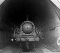 J36 no 65345 stands under the <I>maintenance canopy</I> at Thornton Junction on 11 June 1967, around 2 months after the shed had been officially closed to steam. [Railscot note: This surviving wartime structure, known as a <I>light tunnel</I> was introduced by the LNER to facilitate locomotive maintenance during the blackout. It was 80 ft long and had whitened walls, which were fitted with fluorescent lighting, as was the white glazed brick inspection pit. All lighting was cut off automatically whenever the doors fitted to each end of the tunnel were opened. Thornton men referred to it as <I>The snake pit</I>. [See <I>Living with Locos</I> by Charlie Meacher.]<br><br>[David Pesterfield&nbsp;11/06/1967]