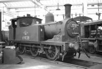 J72 0-6-0T no 69028 stabled inside one of the roundhouses at Gateshead shed in October 1964.<br> <br><br>[Robin Barbour Collection (Courtesy Bruce McCartney)&nbsp;24/10/1964]