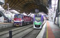 Contrast in V-Line trains at the impressive Melbourne Southern Cross (formerly Spencer Street) station on 12th October 2008.<br> <br><br>[Colin Miller&nbsp;12/10/2008]