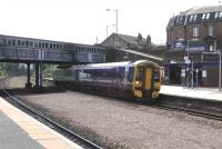 158 709 calls at Larbert with a Glasgow to Dunblane service on 7 May. In the other direction the Larbert Junction signal is set for the Edinburgh line.<br><br>[David Panton&nbsp;07/05/2009]