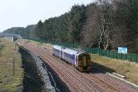 With redoubling and bridge alterations complete, a Bathgate - Waverley service approaches the site of Bangour Jct on 18 March 2009. Electrification is due to arrive soon, marking an end to regular diesel traffic on the line.<br><br>[James Young&nbsp;18/03/2009]