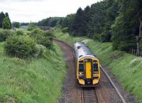Bathgate - Edinburgh train approaches the site of Bangour Junction on the single line branch in June 2007. <br><br>[James Young&nbsp;26/06/2007]