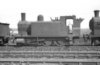 Ex-Caledonian <I>Beetle Crusher</I> 56154, one of the sturdy McIntosh 2F 0-6-0T (original 498 Dock Class) locomotives, stands in the sidings at the Rutherglen end of Polmadie shed, probably in 1959. The locomotive was withdrawn from Polmadie in June of that year and cut up at Cowlairs Works 5 months later. [With thanks to John Robin]<br> <br><br>[K A Gray&nbsp;//1959]