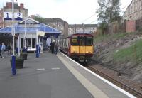 314 203 stands at a smart-looking Queens Park with a Cathcart Outer Circle train on 2 May 2009.<br><br>[David Panton&nbsp;02/05/2009]
