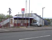 Glasgow Road entrance to Woodhall station on 29 April. Short on well-kept flower beds, no comfy waiting room, but at least there is a ticket office.<br><br>[David Panton&nbsp;29/04/2009]