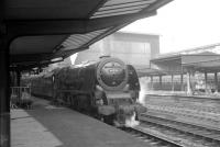 Stanier Pacific 46250 <I>City of Lichfield</I> at Carlisle in 1964 about to take out the 9.00am Perth - Euston train from platform 3.<br><br>[K A Gray&nbsp;29/02/1964]