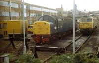 Shortly after being reinstated for Departmental use Class 40 No. D212/40012 <I>Aureol</I>, now renumbered as 97407, sits in Ladywell sidings, Preston alongside an unidentified Class 47. These sidings, to the north east of the station, were swept away when Preston's ring road was extended. The loco was subsequently preserved at the Midland Railway Centre, Butterley. <br><br>[Mark Bartlett&nbsp;//1985]