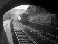 A class 40 locomotive takes the 09.20 Carlisle - Edinburgh Waverley north through Stow station in December 1968. The locomotive is passing through the area currently (2007) occupied by the kitchen of the house which was subsequently built on this spot. [See image 14414]<br> <br><br>[Robin Barbour Collection (Courtesy Bruce McCartney)&nbsp;/12/1968]