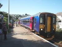 A sizeable number of passengers leaves <I>Bubble Car</I> 153361 at Carbis Bay, having made the short but scenic journey down from St. Ives. The train will continue to the junction at St. Erth calling at Lelant Saltings Park and Ride on the way.<br><br>[Mark Bartlett&nbsp;18/09/2008]