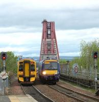 158 and 170 units pass just north of Dalmeny station on 23 May with work in progress on The Bridge in the background.<br><br>[Brian Forbes&nbsp;23/05/2009]