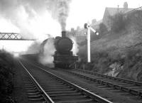 A hard working Q6 no 63379 climbs through Beamish past a notable North Eastern signal post hauling empty steel flats destined for Consett on 15 February 1964.<br><br>[K A Gray&nbsp;15/02/1964]