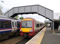 Colour clash at Dalmeny as a pair of 170s restart from the platforms there on 23 May 2009.<br><br>[Brian Forbes&nbsp;23/05/2009]
