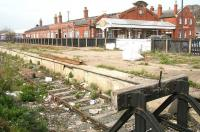 View south west towards Bridlington station over the abandoned excursion platforms 7 & 8 on 23 April 2009.  A Northern 158 service to Sheffield is in the left background standing in bay platform 6. Through platforms 4 & 5 are still used by trains on the line north to Scarborough, while the former platforms 1-3 are now covered by a housing development on the far side of the station.<br><br>[John Furnevel&nbsp;23/04/2009]