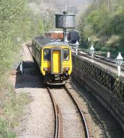 The Northern trains 1038 Middlesbrough - Whitby service has just pulled away from platform 1 at Grosmont on 20 April and is running alongside the rear of the NYMR platform 2 as it accelerates away towards the coast. <br> <br><br>[John Furnevel&nbsp;20/04/2009]