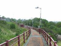 Looking West at Whinhill station in Greenock. The station occupies the site of the trackbed that ran along the second Cartsburn Tunnel, now disused. <br><br>[Graham Morgan&nbsp;23/05/2009]