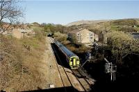 Looking east as Northern Rail 158756 approaches Hall Royd Junction near Todmorden on a York to Blackpool North service on 29 March 2009. The 194 yard Castle Hill Tunnel can be seen in the background.<br><br>[John McIntyre&nbsp;29/03/2009]