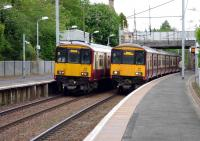 Motherwell bound 318250 and Milngavie bound 318270 await departure from Hamilton West on 27 May.<br> <br><br>[John Steven&nbsp;27/05/2009]