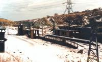 The remains of Dunford Bridge Station, standing at the east end of the 3 mile long tunnel on the closed Woodhead route, pictured following a snowfall in February 1988. View is east, with masts having been removed along the trackbed towards Penistone.<br><br>[David Pesterfield&nbsp;10/02/1988]