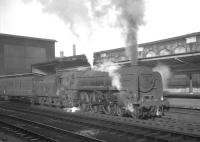 Britannia Pacific no 70032 <I>Tennyson</I> about to leave Carlisle on 30 January 1965 with the mid morning ex-Glasgow Central / Edinburgh Princes Street train for Birmingham New Street.<br><br>[K A Gray&nbsp;30/01/1965]
