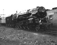 One of the ten ex-Crosti boilered BR class 9F 2-10-0s, 92022, is seen alongside 5C Stafford Shed on 24 June 1962. This particular example was eventually withdrawn from 6C Birkenhead in November 1967 and met its end in the yard at Campbells of Airdrie in April the following year, age 12 years 11 months.<br><br>[David Pesterfield&nbsp;24/06/1962]