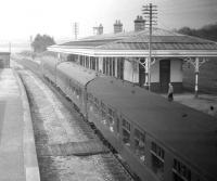 The returning <I>Formartine and Buchan Excursion</I>, with D5323 in charge, makes a photostop at Ellon on 24 May 1969. View is north towards Maud Junction. The old goods yard and Boddam branch line were on the right of the island platform.<br><br>[Robin Barbour Collection (Courtesy Bruce McCartney)&nbsp;24/05/1969]
