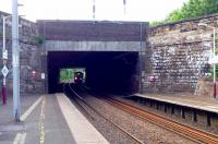 <I>Light at the end of the tunnel</I> as Motherwell bound 318�254 approaches the platforms of Cambuslang station on 3 June.<br><br>[John Steven&nbsp;03/06/2009]