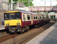 Rear end of 318�264�on a Motherwell bound train at Cambuslang on 3 June.<br><br>[John Steven&nbsp;03/06/2009]