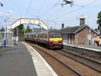 320 318 pulls into Cardross on a service for Drumgelloch on 2 June 2009. Most unusually for the SPT network the station building is original.<br><br>[David Panton&nbsp;02/06/2009]