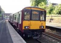 Back end of 318�263 forming a Partick bound train at Cambuslang on 3 June.<br> <br><br>[John Steven&nbsp;03/06/2009]