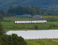 An Alphaline liveried 158 approaches Hilton Junction on the Edinburgh line on 5 June.<br><br>[Brian Forbes&nbsp;05/06/2009]