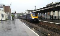 First Great Western HST, with power car 43063 leading, arrives at the end of its journey in rain soaked Paignton on 6 June 2009. The water level between the tracks was slowly rising and expanding during the afternoon as the English Riviera resort was battered by wind and rain.<br><br>[John McIntyre&nbsp;06/06/2009]