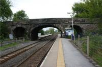 The staggered platforms at Long Preston looking towards Skipton on 17 May 2009. The public access from the road to the northbound platform is on this side of the road bridge. There is a narrow section of platform under the bridge to access the platform shelter at the far end. There is a notice warning pasengers not to stand on this section of platform as trains approach. <br><br>[John McIntyre&nbsp;17/05/2009]