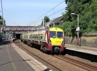 A 6-car 334 combination on a service to Motherwell via Blantyre seen at Cambuslang on 1 June 2009<br><br>[David Panton&nbsp;01/06/2009]