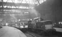 Scene at Princes Street station on 3 September 1965 with a DMU preparing to leave platform 4 and a Clayton ready to take the 2.5pm to Manchester as far as Carstairs.<br><br>[K A Gray&nbsp;03/09/1965]