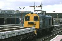 A permanent way train headed by 20 213 waits for a path north at Stirling in March 1986. A Class 27 loco was attached at the other end. The signal gantry survived until April 2008 when it was replaced in connection with the reopening of the line to Alloa.<br><br>[Mark Dufton&nbsp;/03/1986]