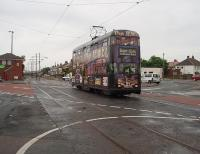 Heading for the Starr Gate southern terminus No. 707, a 1930s double deck <I>Millennium</I> car with a new body on the original frames, leaves Broadwater tram stop and crosses the busy road before rejoining the independent section of track that runs across fields to Rossall School. This location changed significantly when the tramway was refurbished and a level access tram stop behind the camera position replaced the original.  <br><br>[Mark Bartlett&nbsp;10/06/2009]