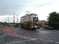 Most of the Blackpool tramway follows the main coastal road but at Rossall School the trams veer North East to run across the peninsula and access Fleetwood's main street. Here No. 721, a double deck car in advertising livery heading for Fleetwood, runs into Broadwater, part way along that section of the line.<br><br>[Mark Bartlett&nbsp;10/06/2009]