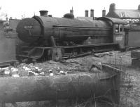 Gresley class D49 no 62727 <I>The Quorn</I> awaits the cutter's torch in Darlington works scrapyard on 12 March 1961, around 2 months after being withdrawn from  53A  Hull Dairycoates shed. Disposal date is recorded as 7 weeks later on 30 April 1961. [Note the locomotive's nameplate is still attached!]<br> <br> <br><br>[David Pesterfield&nbsp;12/03/1961]