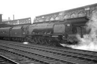 Stanier <I>Coronation</I> Pacific no 46250 <I>City of Lichfield</I> stands in the rain at Carlisle's platform 4 ready to take out special troop train 1X68. <br><br>[K A Gray&nbsp;30/05/1964]