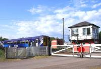 A southbound service on the ex-GSWR route about to run over Holywood level crossing on 10 June, heading for its next stop at Dumfries. This is one of the very few level crossings that is manually operated from the box by wheel.<br><br>[David Forbes&nbsp;10/06/2009]
