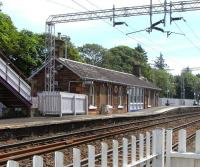 View east at Cardross on 2 June 2009. Not only is the original station building still standing here, but it has recently been given a fresh coat of paint.<br><br>[David Panton&nbsp;02/06/2009]