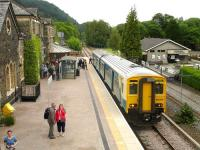 The 1620 service from Llandudno, formed by Arriva Trains Wales unit 150264, drops a large contingent of passengers at Betws-y-Coed on the Conwy Valley line on 12 June 2009. The train will continue from here as the 1701 to Blaenau Ffestiniog. On the right is part of the Conwy Valley Railway Museum, built on the site of the old goods yard. [The name Betws-y-Coed, which translates as <I>Prayer house in the wood</I>, has been spelled with one T since June 1953] <br><br>[David Pesterfield&nbsp;12/06/2009]