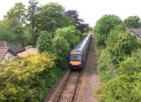 Ten minutes after leaving Perth on 13 June, a southbound First Scotrail DMU en route to Edinburgh runs past the site of Bridge of Earn station.<br><br>[David Forbes&nbsp;13/06/2009]