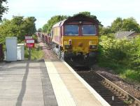 PW train number 8K63 at Kilmaurs on 13 June 2009 with EWS locomotive 66122 nearest the camera. Various engineering activities were being undertaken along the line over the weekend, including replacement of drains, points installation and platform work at Dunlop, involving some 8 separate trains. <br><br>[Ken Browne&nbsp;13/06/2009]