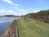 The kickback on the former Pier sidings at Wemyss Bay on 1 June,  with the chimney of the disused Inverkip power station in the distance.<br><br>[David Panton&nbsp;01/06/2009]
