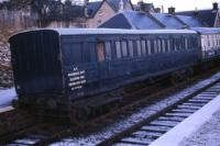 Former North British Railway non corridor bogie lavatory third coach no 1748 of 1905 which survived into BR ownership as the Edinburgh District Engineers Dept Sleeping Van ED 970012. It is seen in late 1973 at Boat of Garten station having been acquired by the Strathspey Railway and was used for a number of years as accommodation for volunteers. To the right is an ex LNER Gresley First Class Sleeping Car in weathered BR Blue & Grey.<br><br>[John McIntyre&nbsp;//1973]
