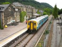 Arriva Wales 150264 on the 17.01 service to Blaenau Ffestiniog at Betws-y-Coed on 12 June. The narrow gauge tracks of the Conwy Valley Railway Museum run alongside the station on the right.<br><br>[David Pesterfield&nbsp;12/06/2009]