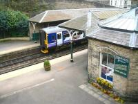 Looking over the east end of Knaresborough station on 24 April 2009. A Northern trains service for Leeds awaits its departure time at platform 1 as a customer visits <I>Fireplaces of Yesteryear</I> on platform 2.<br> <br><br>[John Furnevel&nbsp;24/04/2009]