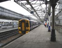 An Inverness service, formed by 158 716, prepares to leave Aberdeen platform 7N on 15 June 2009. Note the abandoned platforms 8 & 9 behind the fence to the right where a single through line now runs along the centre of the formation.<br><br>[David Panton&nbsp;15/06/2009]